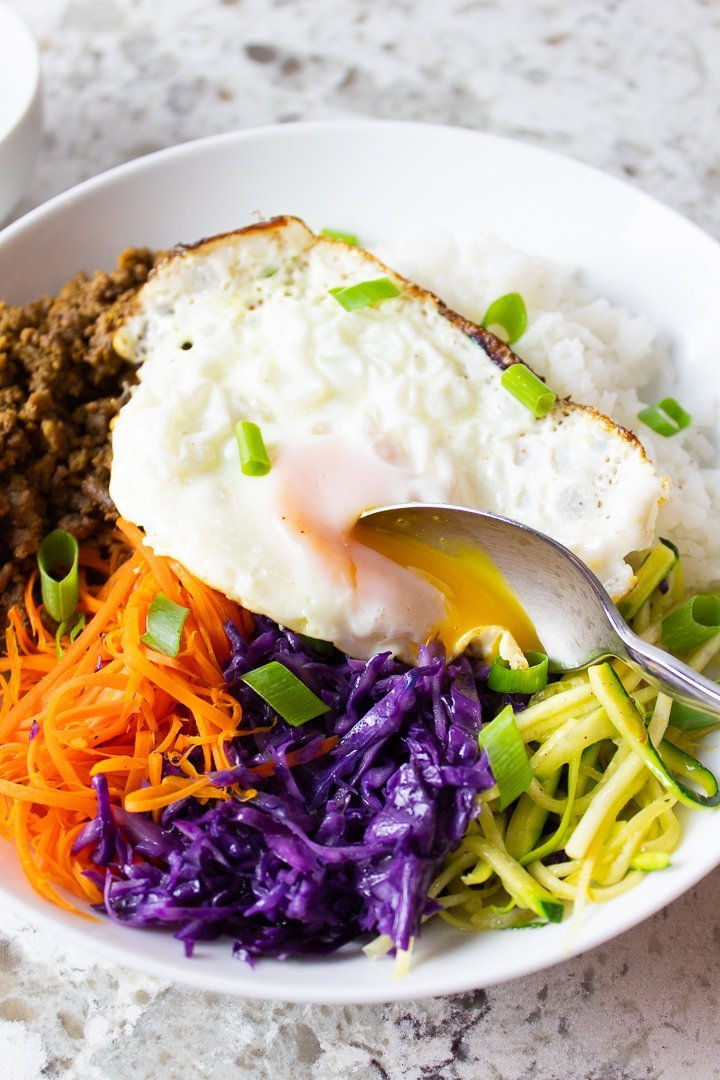 AIP Bibimbap with a runny egg on top.