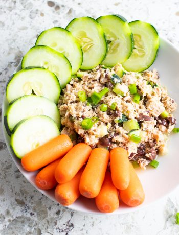 No-Mayo Greek Tuna Salad in a bowl with cucumbers and carrots.