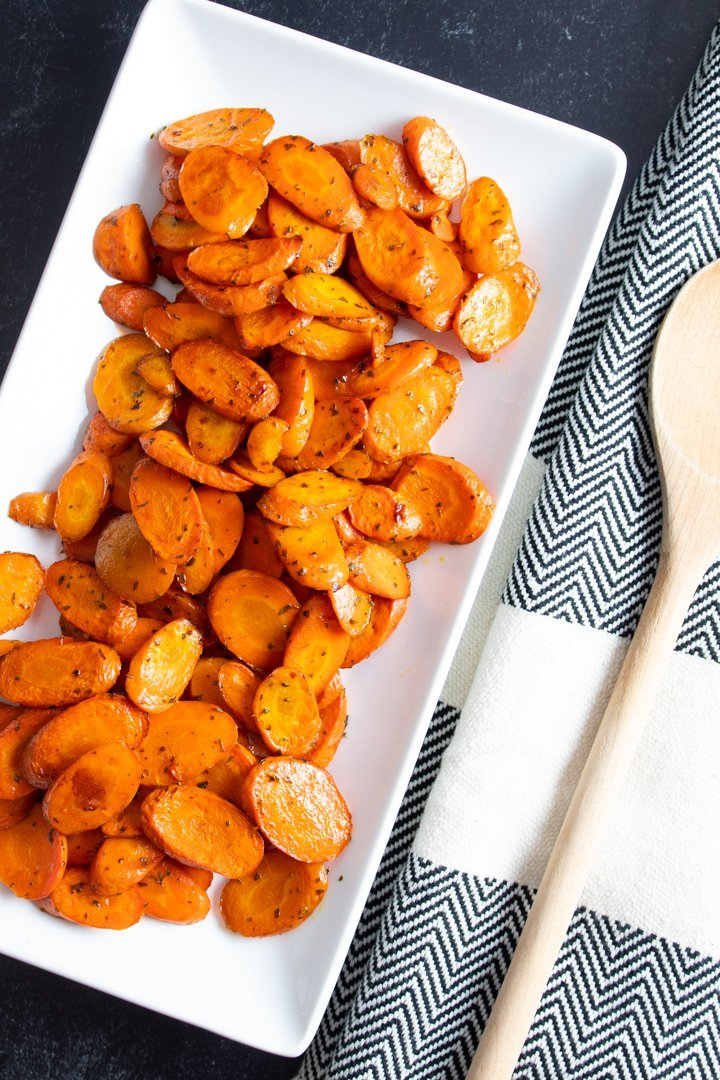 Savory Balsamic Roasted Carrots arranged on a serving platter.