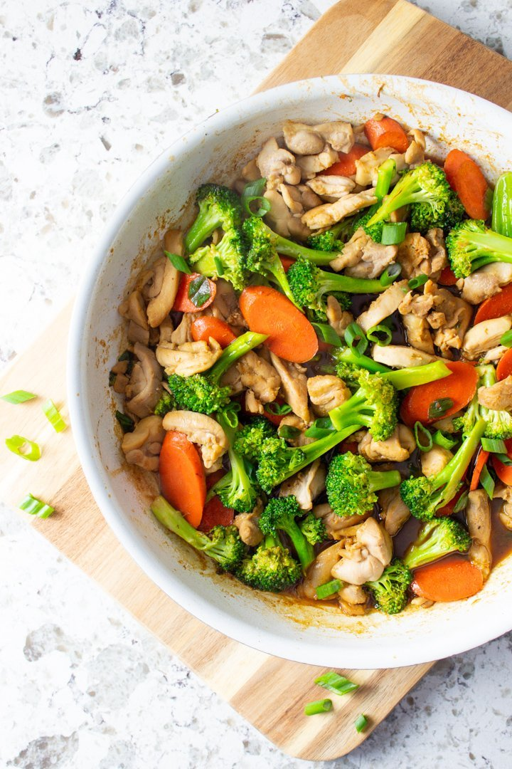 Top view of Easy AIP Chicken Stir Fry in a white skillet.