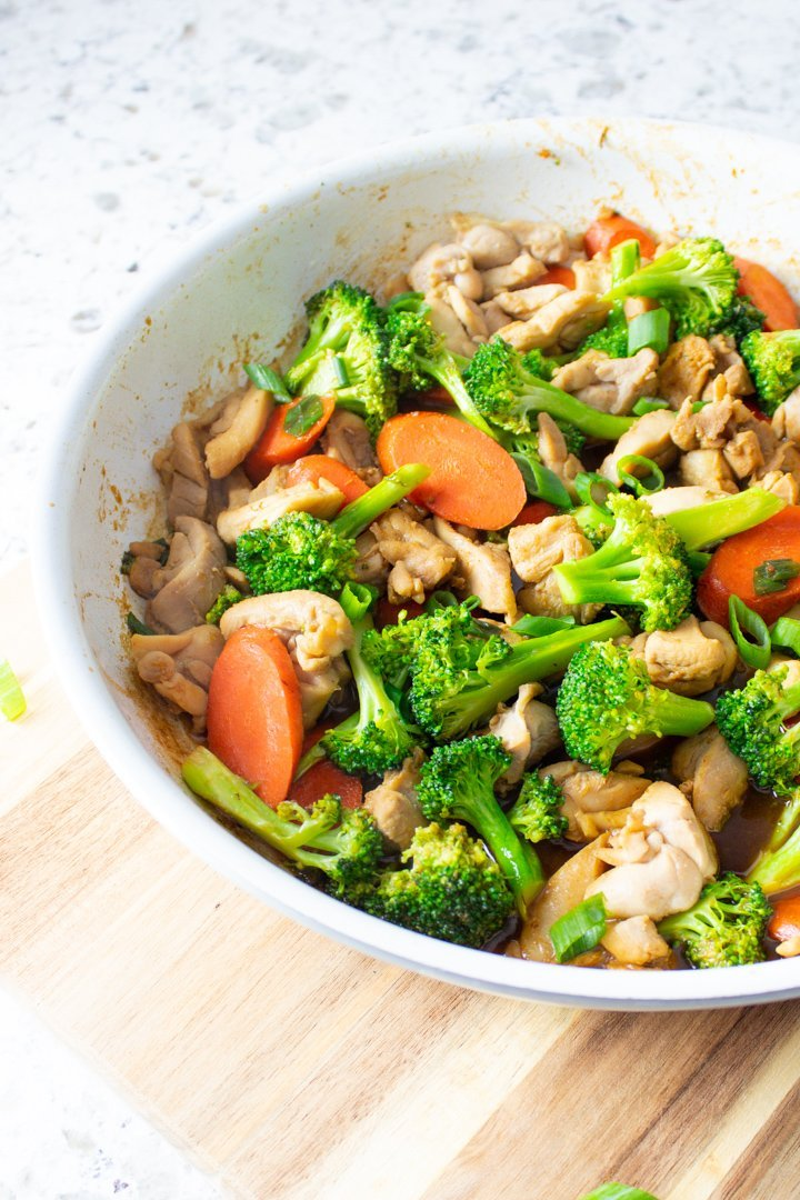 Easy AIP Chicken Stir Fry in a white skillet.