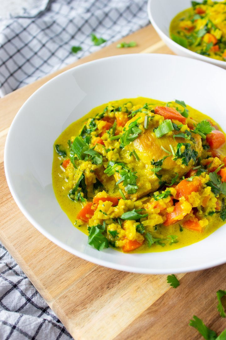 Close up of Turmeric Chicken and Cauli Rice in a white bowl.