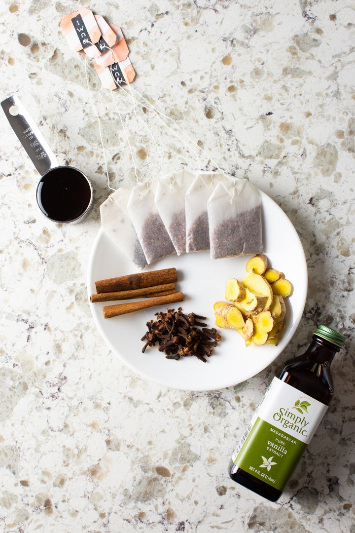 AIP Chai Tea Latte Concentrate ingredients arranged on a stone countertop.
